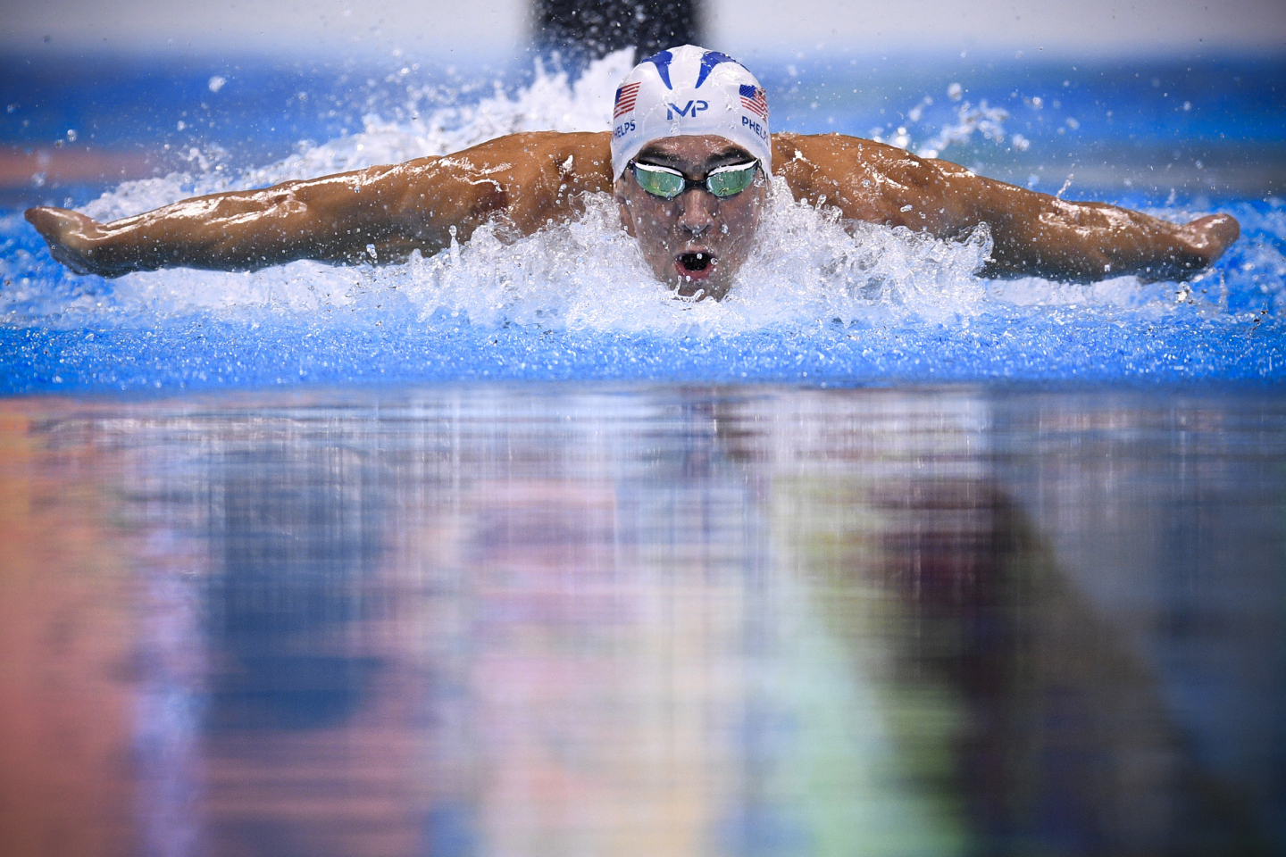 USA's Michael Phelps competes in a Men's 200m Individual Medley heat during the swimming event at the Rio 2016 Olympic Games at the Olympic Aquatics Stadium in Rio de Janeiro on August 10, 2016.   / AFP PHOTO / Martin BUREAU