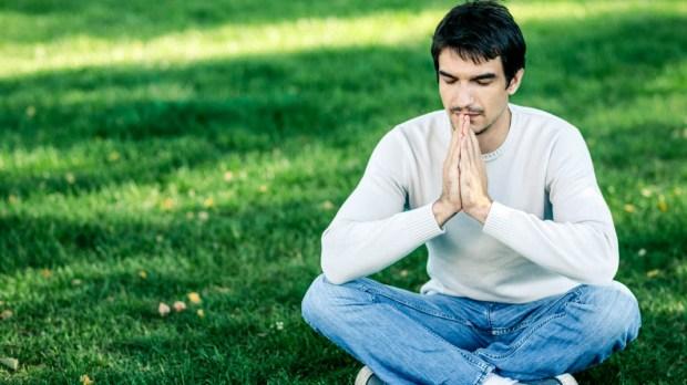 MAN MEDITATING IN PARK
