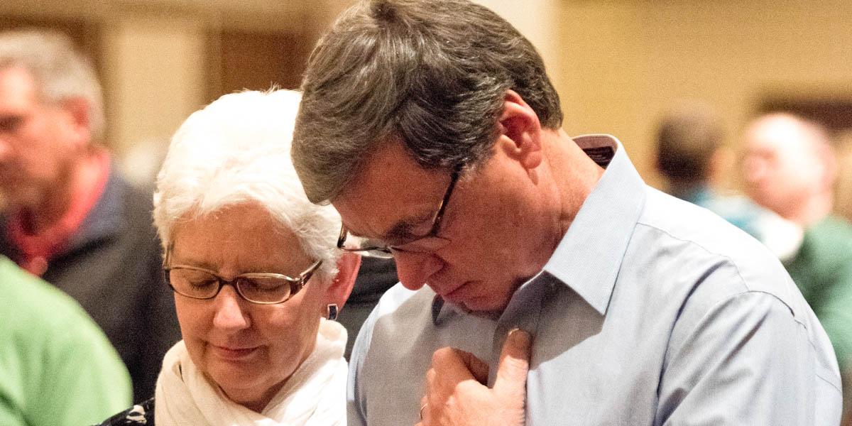 MAN AND WOMAN,PRAYING