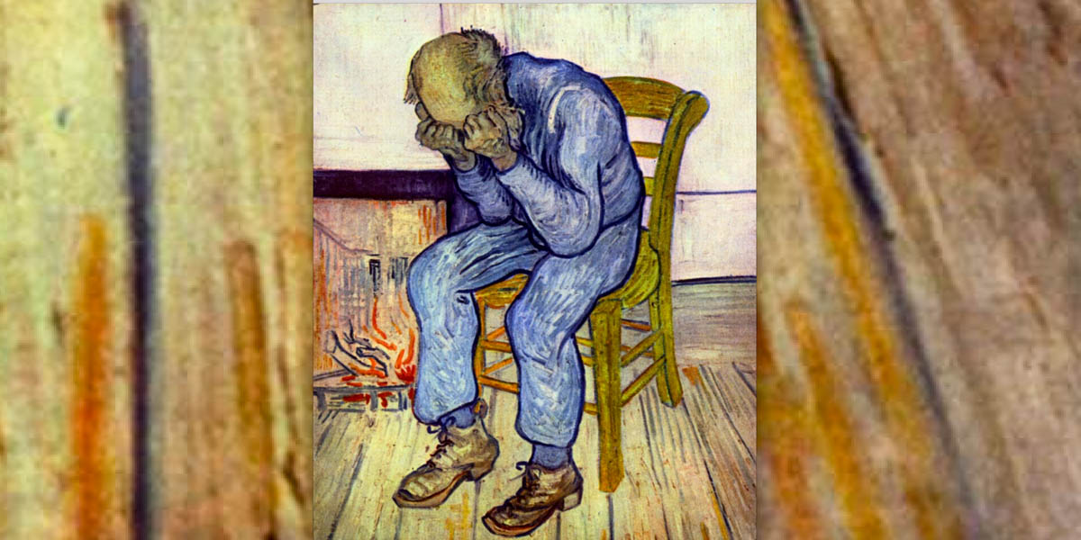 SAD MAN SITTING BY THE FIRE