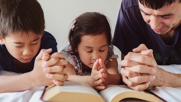 PARENT AND CHILDREN PRAYING
