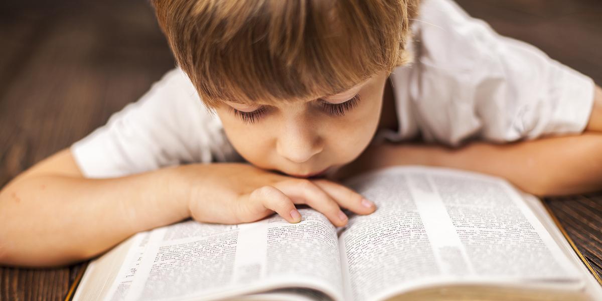 LITTLE BOY READING BIBLE