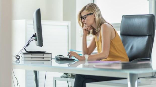 WOMAN,WORKING,DESK,OFFICE