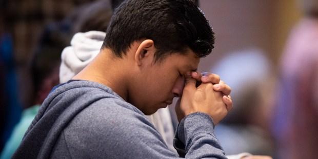 PRAYING,PRAYER,YOUNG MAN