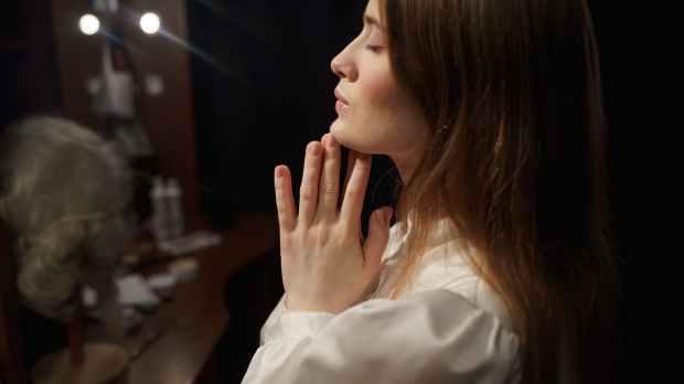 woman in white long sleeve shirt praying