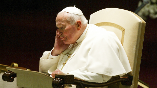 VATICAN CITY, VATICAN - 18 OCTOBER 2003: Pope John Paul II concentrates during the weekly general audience in the Nervi Hall at the Vatican.