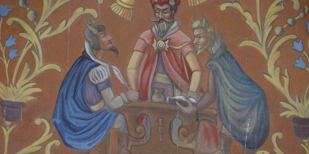 Fragment elewacji kamienicy Rynek 4 w Lublinie z przedstawieniem diabelskiego sądu